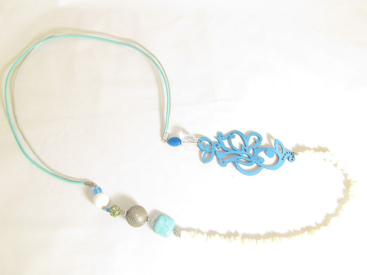 Handmade long necklace with turquoise leather filigree (1 pc)  Made with turquoise leather filigree, leather cords, crystals, semiprecious stones and glass beads.