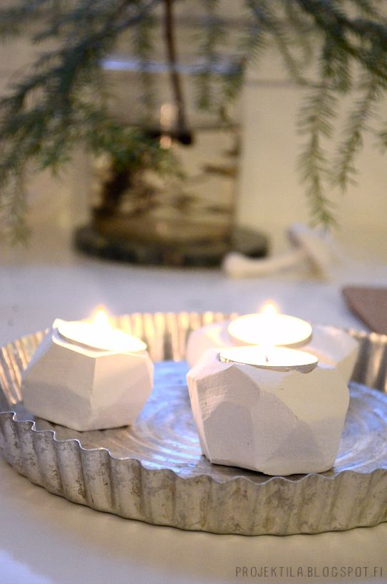 Idea from: http://www.gatheringbeauty.com/2013/07/diy-faceted-clay-tealight-holders.html#.UodHEdK9lbx