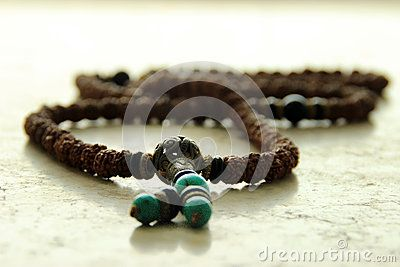 Which is composed of green and fine delicate beads,parts are made of copper.