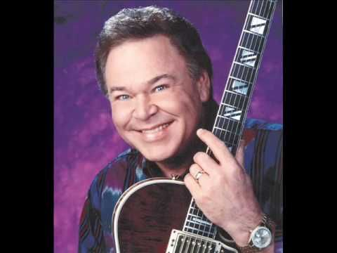 "Roy Clark ""Thank God And Greyhound""  I first heard this on ""Hee Haw"" in my most impressionable youth (obviously).  I never forgot it... How could I????"