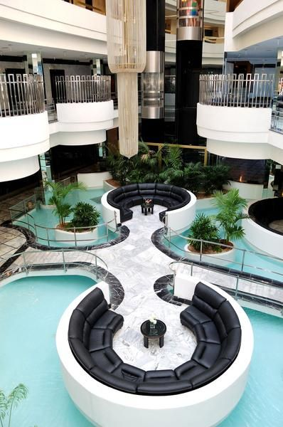 Hotel Lobby Designs - lobby pool - attractive, helps create better feeling of separation/privacy between spaces