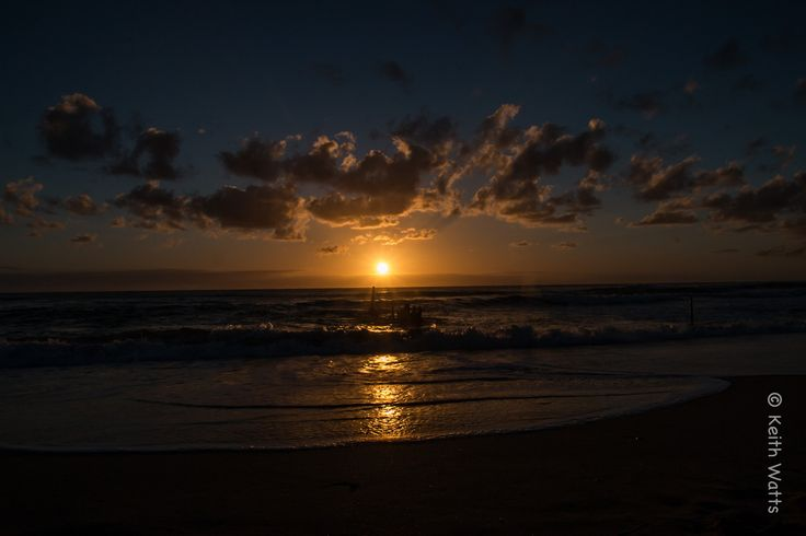 Sunrise over the SS Dicky - The sun rises over the skeletal remains of the SS Dicky where it lies on Dicky Beach