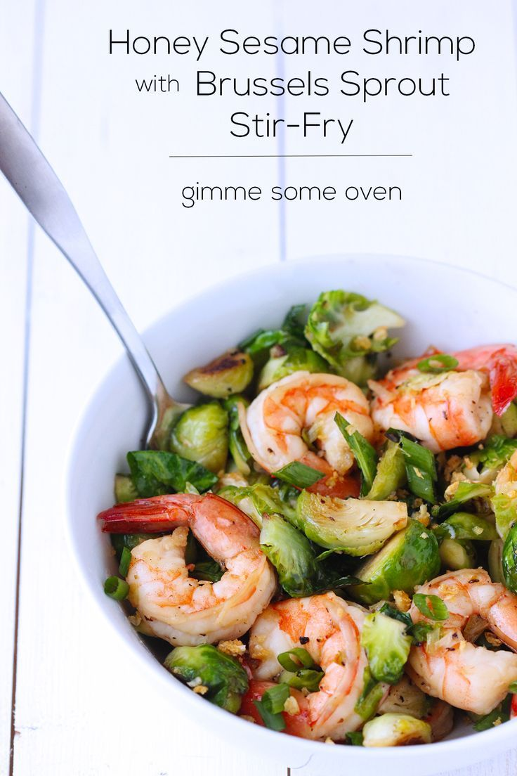 Honey Sesame Shrimp with Brussels Sprout Stir Fry. A healthy stir fry recipe that is perfect for a weeknight dinner.  Use olive oil or avocado oil rather than vegetable oil to keep this healthy recipe clean eating friendly. Pin now to make this shrimp dish later.
