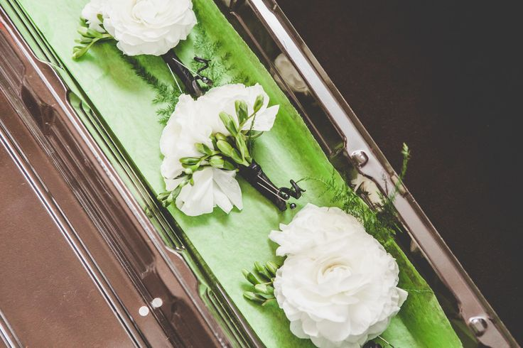White Ranunculus Boutonnières for the groomsmen http://www.fusion-events.ca/