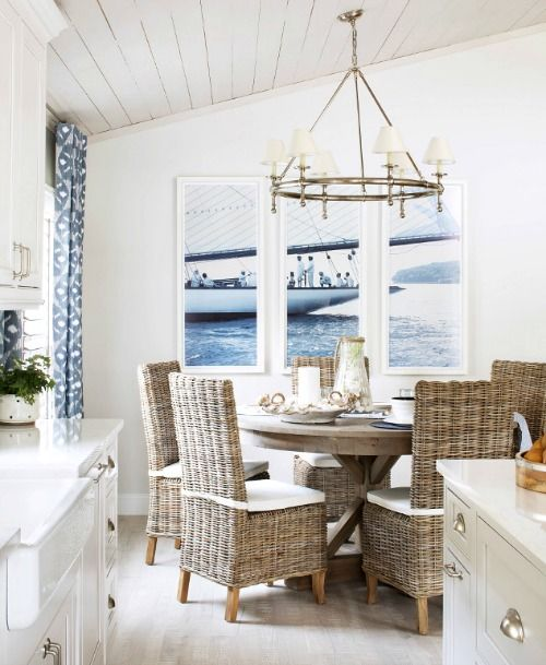Coastal Nautical Dining Room with Rattan Chairs... http://www.completely-coastal.com/2016/09/nautical-living-navy-blue-white.html