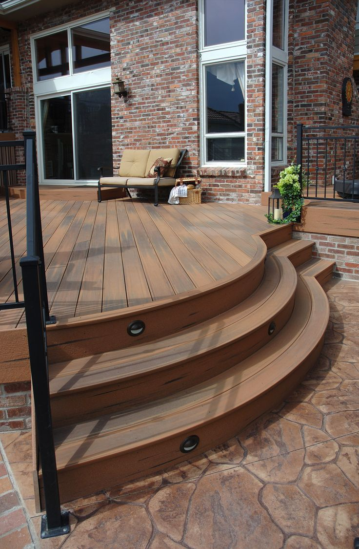 Patio with curved stairs this is fiberon composite for Low price decking