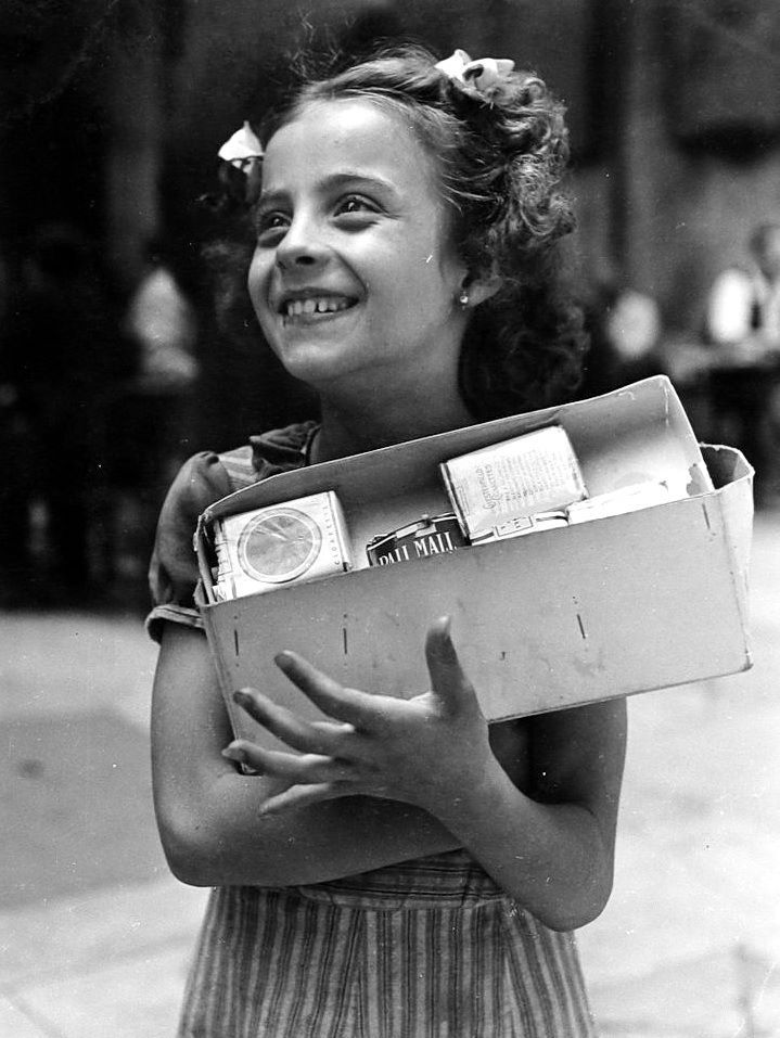 """Young Girl selling cigarettes on the street""  Photo: David Seymour (1911 - 1956) Italy - Naples, 1950"