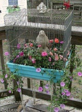 beautiful turquoise blue bird cage used as planter