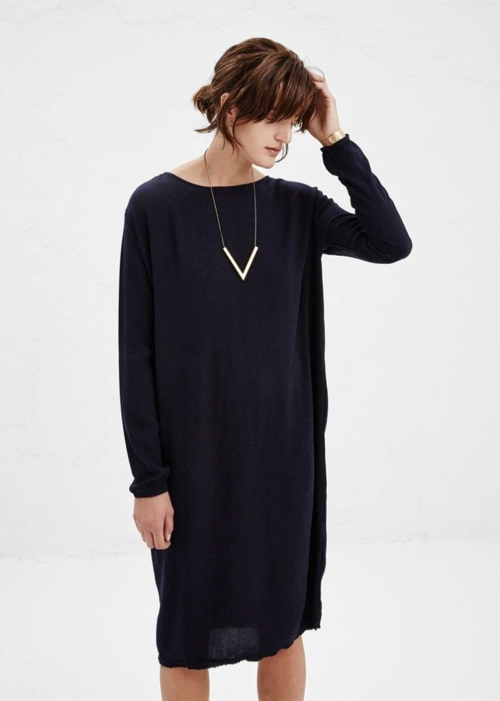 oversized black sweater dress + simple gold statement necklace