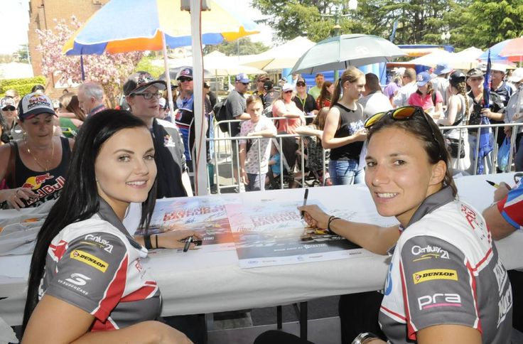SUPER GIRLS: V8 Supercars drivers Renee Gracie and Simona de Silvestro are the first all-female team in almost 20 years to tackle iconic Mount Panorama. They had lots of fans at yesterday's driver signing session in Kings Parade. Photo: CHRIS SEABROOK 100715cgirls1a
