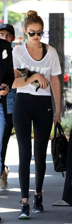 Who made Gigi Hadid's white tee, black leggings, and sneakers?