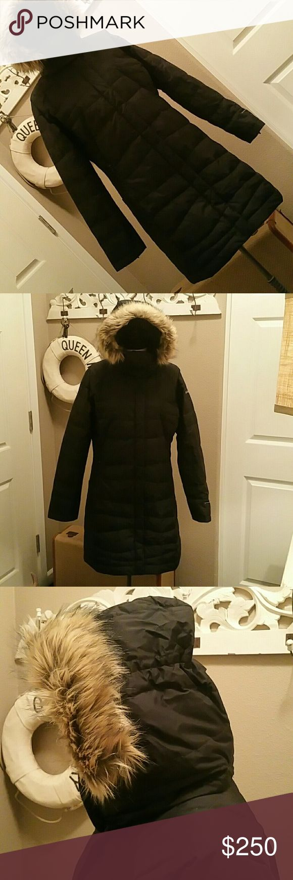 Columbia Sportswear Long Titanium Down Puffer Coat NWOT gorgeous down filled coat. Faux fur lined removable hood. This is the real thing and quality to last a life time. Similar style selling now for $500. If you need a stylish super warm coat...this is it!! Columbia Sportswear Jackets & Coats Puffers