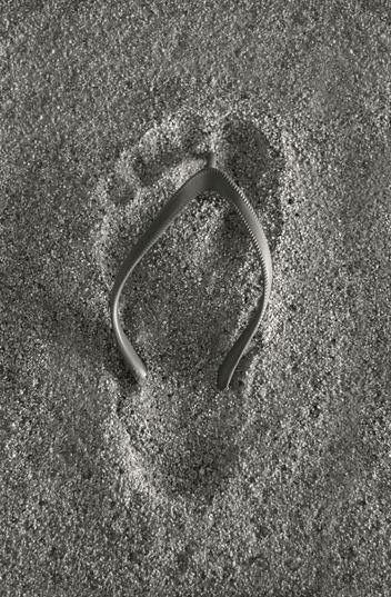 Grey | footprint in the sand