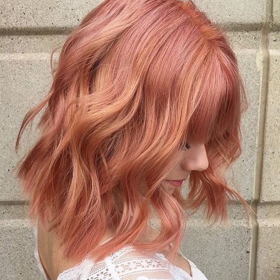 An Aveda Color trend we'll never stop loving: rose gold hair color. This shade by Aveda Artist Sav is practically perfect on a short haircut with bangs.