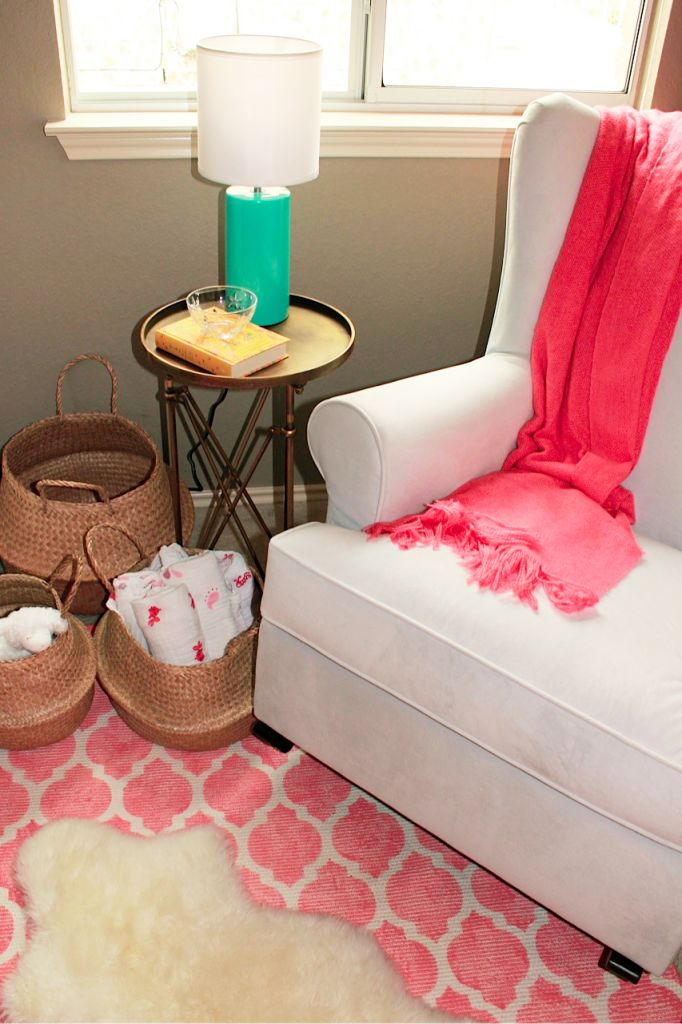 Nursery glider perfection: table to hold lamp and water for Mom, baskets of blankies for cuddling.