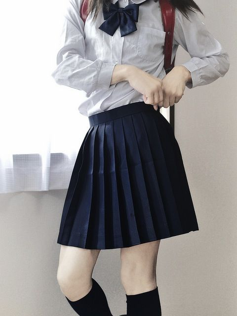 Definitely like the idea of pleated skirts, button down blouses, and a neck scarf tied into a bow