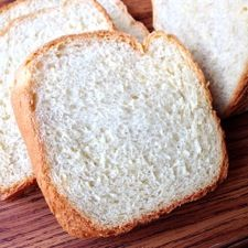 For those of you who don't feel like doing a lot of rolling and cutting, here's an English muffin bread developed for the bread machine. It makes a mild-flavored, light-textured 1 1/2-pound loaf, perfect for toast.