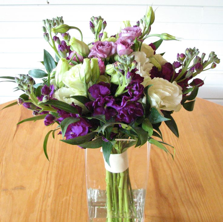 Purple and white bouquet filled with purple stock creamy for Flower sprays for weddings