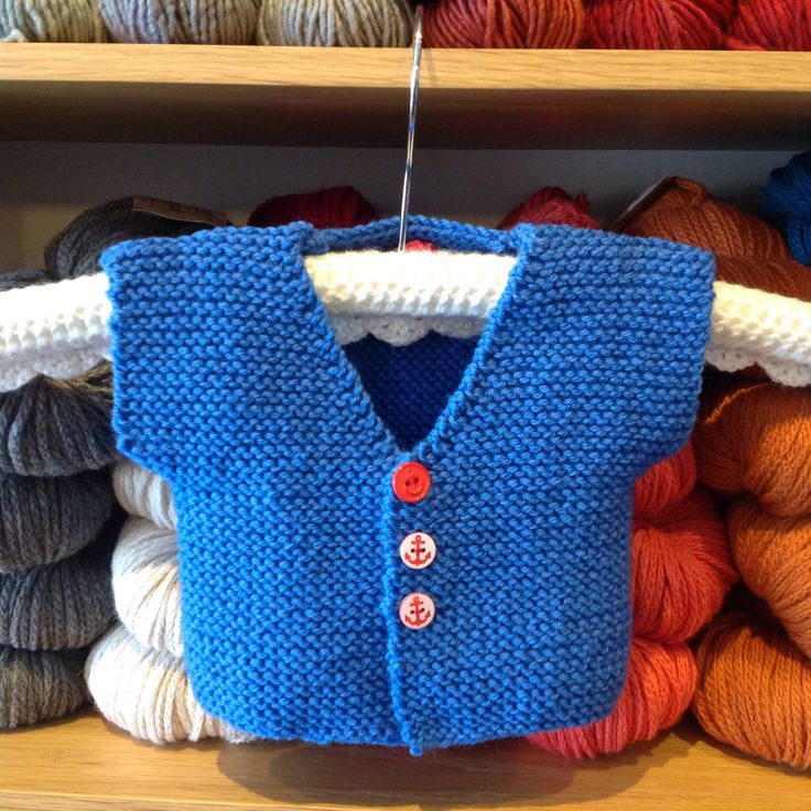 I just love those buttons on this cute little baby vest