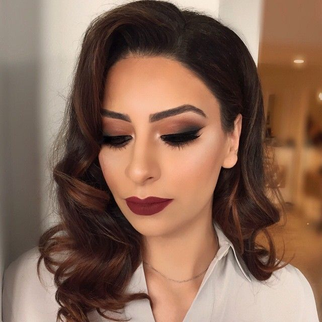 Love this classic Hollywood beauty look for prom. Dark bold eye and dark lip! The soft curls are amazing too.