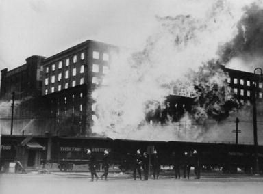 1935 fire at Goldsborough Mort & Co woolstore,  firefighters  and Goods Line trains in foreground. The whole of the Metropolitan Brigades were ordered out and there were 20 engines and about 230 men fighting the blaze: Helen