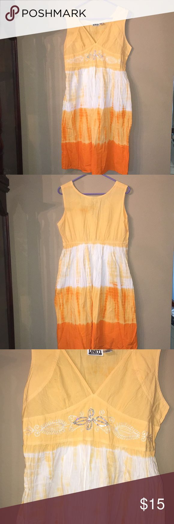 Orange and White Dress This is a beautiful orange and white dress 👗 with a sparkly design on the front.  🧐CONDITION - Good   🤔FLAWS - Little to none   🤓BRAND - Uniti Casuals   🛑NEGOTIABLE🛑 Uniti Casual Dresses High Low