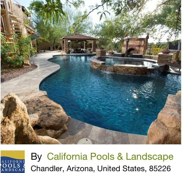 Freeform pool with raised spa and naturalistic elements-SR