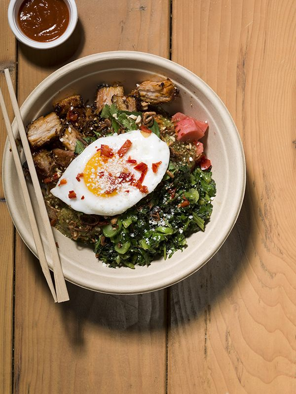 At Chego in #LA, sample a pork belly bowl served with scallion, poached egg and plenty of Sriracha. Photo by Misha Gravenor.