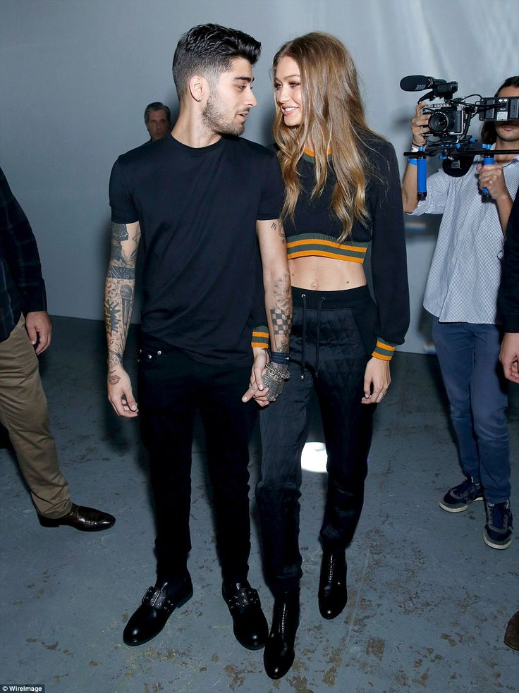 The look of love! Zayn Malik and Gigi Hadid only had eyes for each other as they stylishly arrived at the Versace catwalk event at London Fashion Week on Saturday hand-in-hand