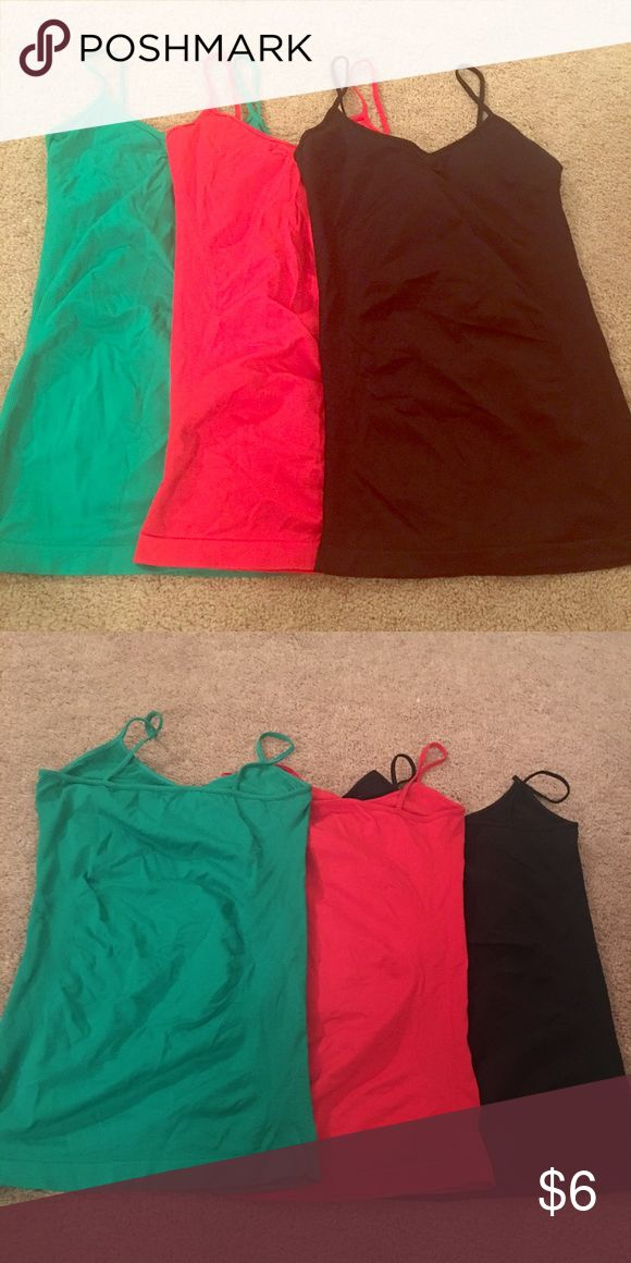 Stretchy tank tops bundle 🍄 excellent condition Green red and black. All 3 or make an offer for 1 or 2 or other items in my closet. Gym like:  Nike, Adidas, Asics, Lulu lemon, north face. Tops Tank Tops