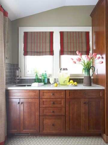 wood cabinets, white countertops - interesting paint color & those shades are an ooolala eye-catcher