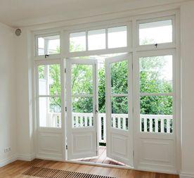 Mooie openslaande tuindeuren met bovenlicht