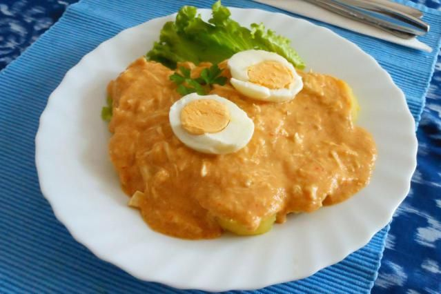 Aji de gallina is a classic Peruvian dish, made with aji peppers, chicken, and a cream sauce.