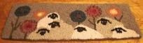 Hooked sheep rug WATCHING $50.00