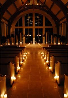 Evening wedding - sanctuary lit with candles - and if in December the giant Christmas tree behind the altar at church with all its perfect twinkling white lights
