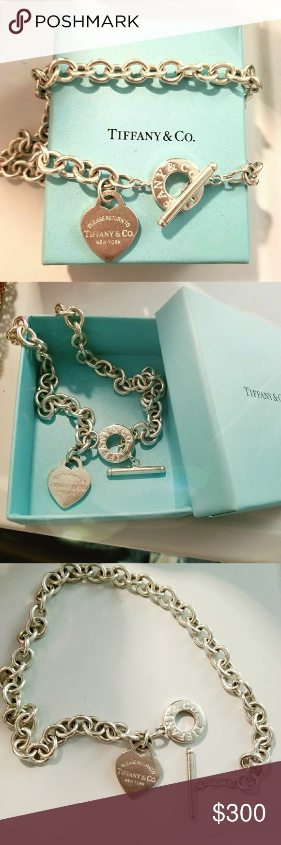 """Authentic Tiffany & Co. Toggle Heart necklace Authentic Tiffany & Co. """"Please Return To Tiffany & Co New York"""" Toggle Heart necklace set in sterling silver. Good, used condition and comes with box!   Price is negotiable! Tiffany & Co. Jewelry Necklaces"""