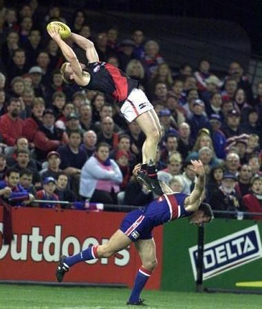 "This spectacular catch by a player from the Essendon Bombers is called a ""mark,"" a designation given when a ball is caught within the 10-meter line of the goal..."