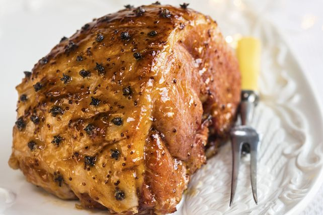 Fig balsamic dressing, brown sugar, whole cloves and a touch of Dijon mustard transform an ordinary baked ham into an oh-so-good sweet-and-tangy glazed ham.