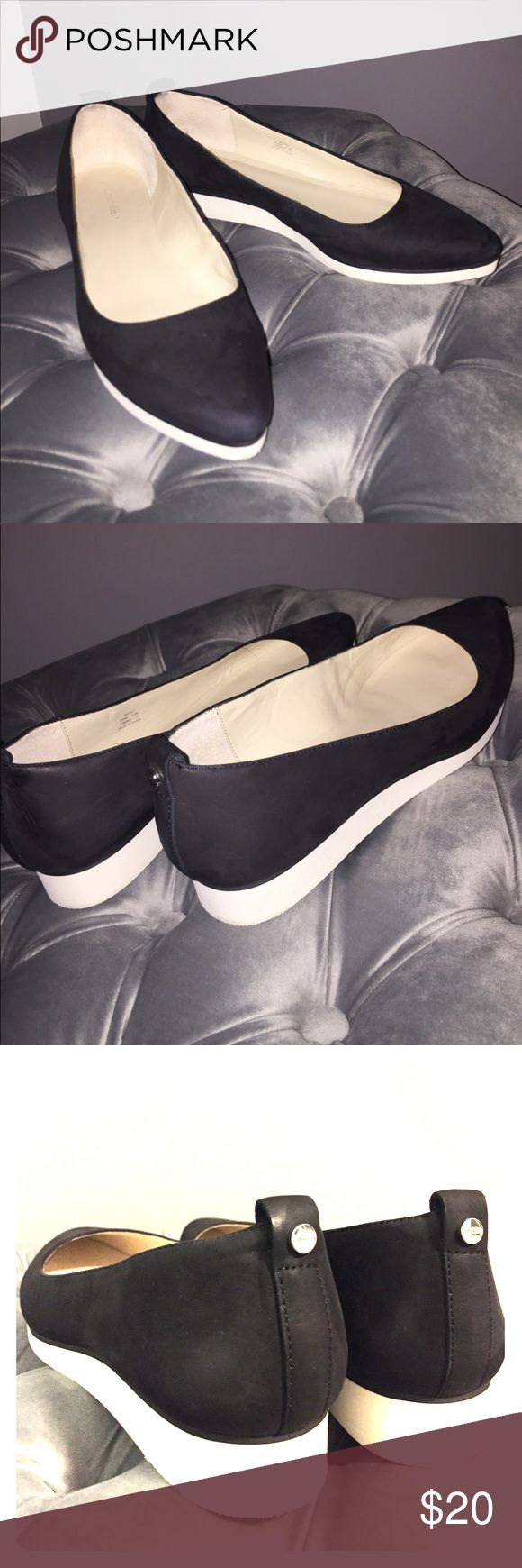Black and white Calvin Klein slip on shoe Black and white Calvin Klein slip on shoe. Size 8.5 Medium. Worn twice. I deep cleaned them. White foam sole. Clean inside. Slightly pointed toe front. Very cute shoe! Calvin Klein Shoes Flats & Loafers
