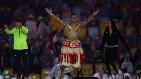 Pita Taufatofua of Tonga jumps on stage during the Closing Ceremony on Day 16 of the Rio 2016 Olympic Games