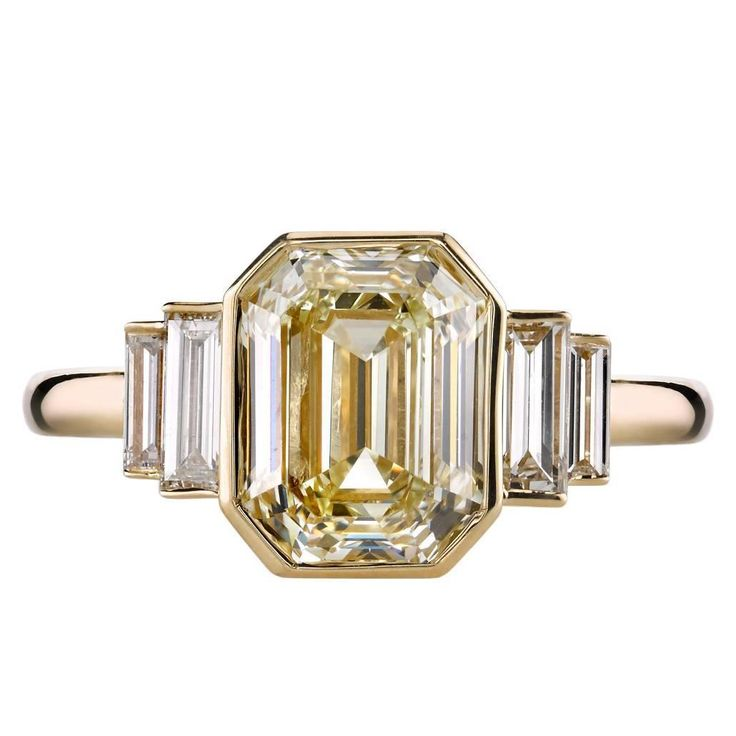 Single Stone 3.06 carat Art Deco Emerald Cut Engagement Ring | 1stdibs.com | $30,000 USD | 3.06ct M/VS2 HRD certified Emerald cut diamond set in a handcrafted 18k yellow gold mounting. A classic and sleek design featuring bezel set diamonds and baguette accents.