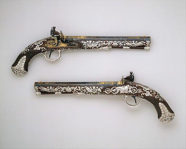 Pair of Flintlock Pistols Silversmith: Attributed to Michael Barnett (English, London, 1758–ca. 1823) Date: hallmarked for 1800–1801 Geography: London Culture: British, London Medium: Steel, walnut, silver, gold