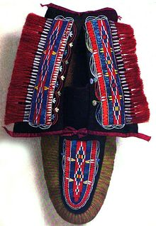 Huron quillwork moccasin. Quillwork is a form of textile embellishment traditionally practiced by Native Americans that employs the quills of porcupines as an aesthetic element.