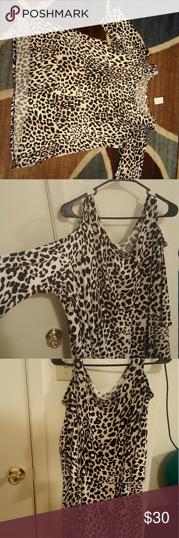 Fabulous cheetah print peek boo shoulder shirt This soft cheetah print peek boo shoulder shirt would like amzing with black waist belt, legging and cute heels Cato Tops Tunics
