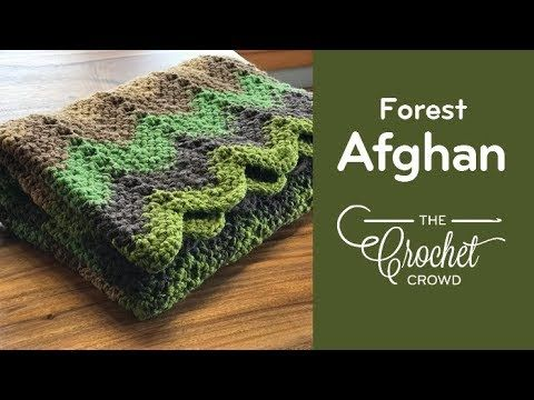 Crochet this Through the Forest Afghan for your home decor. Perfectly for non-bulky look on a sofa or even use for someone in a wheel chair. This afghan is 3...