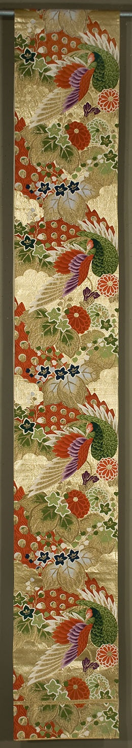"""Japanese Fukuro Obi  11¾""""x 158""""  Decorated section:  11¾""""x 100""""  Gold lamé with silk and  metallic brocading.  Peacock motif.  Red, green, purple and white silk brocading, along with gold and silver brocading"""