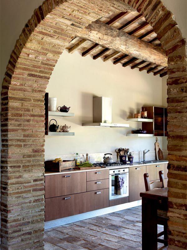 brick archway + beamwork in rustic modern kitchen via period living