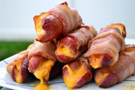 Bacon wrapped cheese dogs on @Traeger Grills