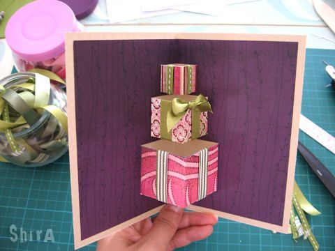 Pop up card from here: http://littlegreenbox.wordpress.com/2010/05/06/a-pile-of-gifts-pop-up-card/ tutorial