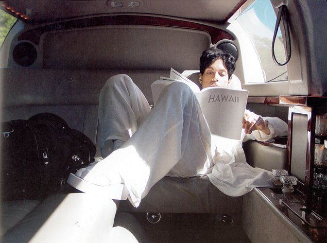 Prince living in a limo -- all white.